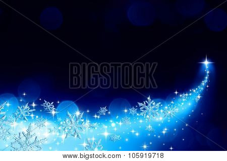 Christmas background with a trail of stardust and snowflakes