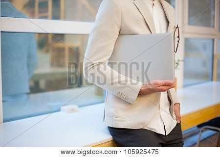 Closeup Of Stylish Employee With Laptop