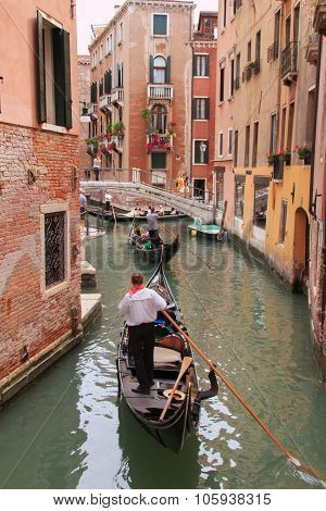 Gondole In A Canal Of Venice