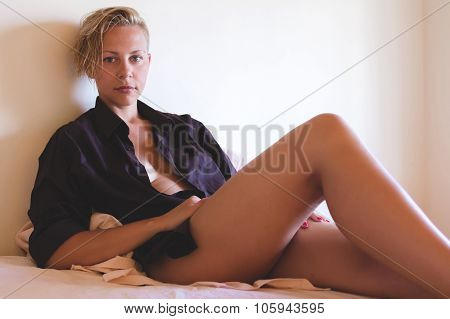 Sexy model in man's shirt without make-up