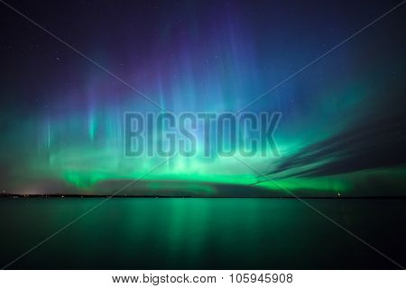 Beautiful northern lights aurora borealis over lake in finland poster