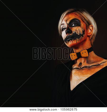 Halloween Portrait Of Body Art Pumpkin Girl With Pumpkin Bowtie On Black Background. Real Greasepain