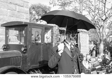 Man With Sugar Skull And Umbrella