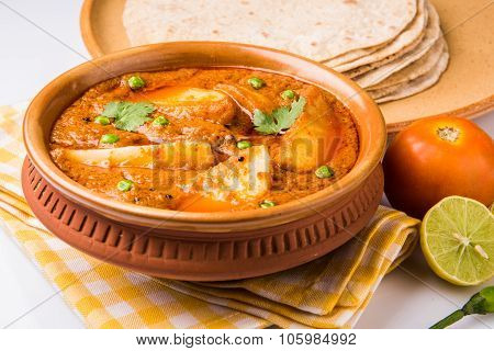 indian potato curry with chapati or roti