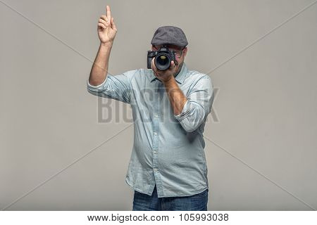 Man Taking A Photograph Pointing Up