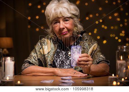 Tarot Reader Holding Magic Card