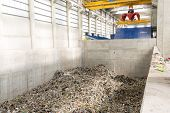 Inside of a waste management facility. Treatment and disposal of waste. Prevention of waste production through in-process modification reuse and recycling. Convert waste materials into new products. poster
