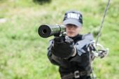Female police officer SWAT during assault operation poster