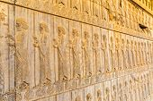 Guardians also known as the Immortals holding a spear, relief detail on the stairway facade of the Apadana at the old city Persepolis. poster