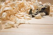 Hand jointer and shavings on pine boards poster