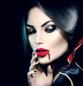 Vampire Halloween Woman portrait. Beauty Sexy Vampire Girl with  dripping blood on her mouth. Vampire makeup Fashion Art design. Attractive model girl in Halloween costume and make up  poster