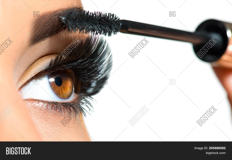 8b7e6576428 Long Lashes closeup. Mascara Brush. Eyelashes extensions. Makeup for Brown