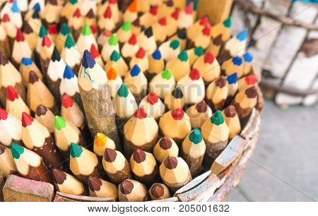One of the pencils selected among the heap of other color pencils