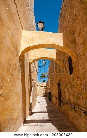 Narrow medieval street in the citadel of Gozo Malta