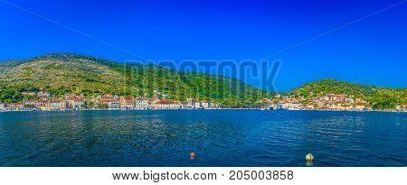 Summer panorama of coastal town Vis in Croatia, popular tourist resort on Adriatic Sea, Europe.