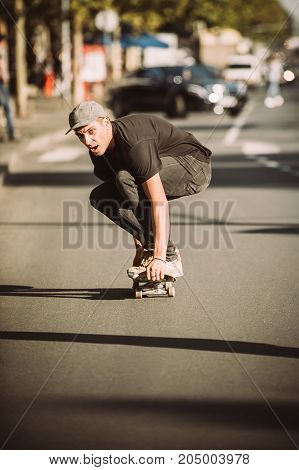 Skateboarder Ride A Skateboard Slope Through The City Street