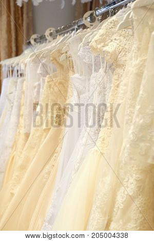 White and cream colored wedding dresses vertical