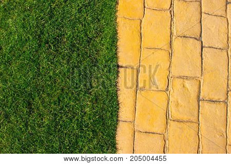 Lawn. Yellow brick road. Summer park background.