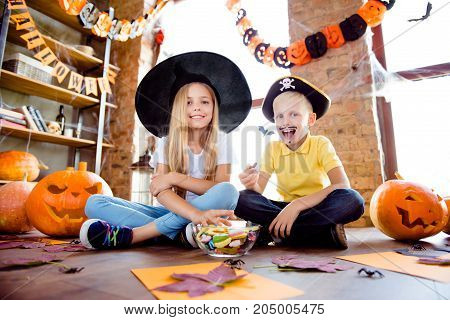 Treat Or Trick! Dessert! Cheerful Amazed Excited Small Kids In Carnival Head Wear, With Colorful Tre