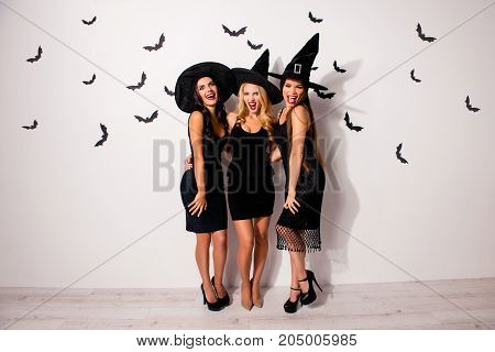Full Length Of Three Terrifyng Mysterious Emotional Flirty Dark Mistress Monsters In Elegant Costume