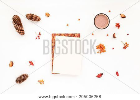 Autumn Workplace. Notebook, Pine Cone, Cup Of Coffee, Marshmallow On White Background. Flat Lay, Top