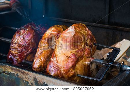 Pork ham meat is roasted on the open fire on Street of Prague in Czech Republic
