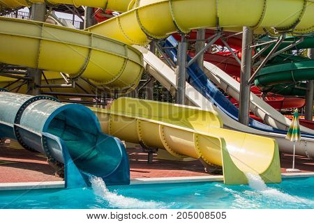 Swimming Pool Slides For Child On Blue Water Slide At Aquapark