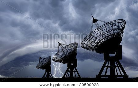 Satellite dishes at thundershtorm.