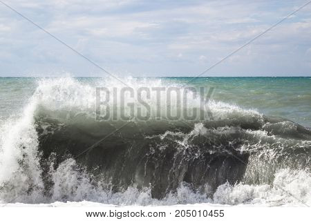 The Formation Of A Large Storm Wave Over The Water With Foam