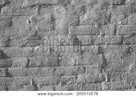 Textured white brick wall background. Real photo of ancient rough surface.
