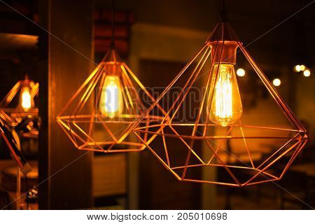 Lighting lamp is hanging at ceiling, spider web design lamp