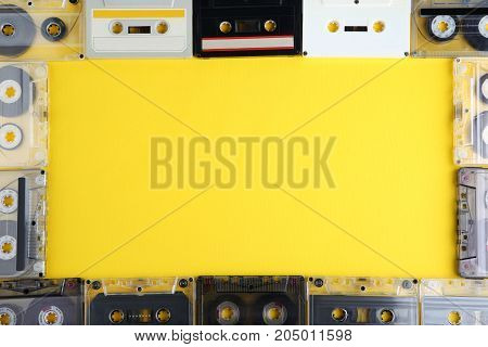 Old cassette tapes on the yellow background