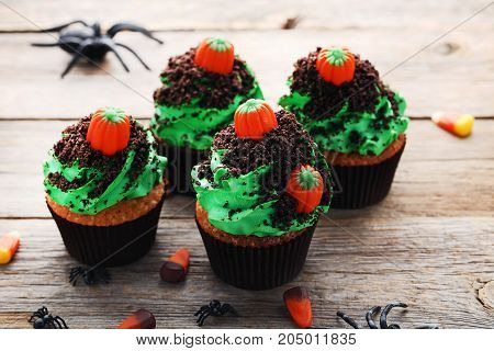 Halloween cupcakes on the grey wooden table