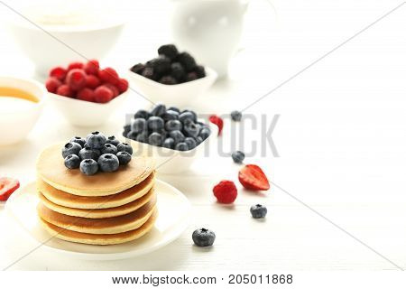 Tasty Pancakes With Blueberries On White Wooden Table