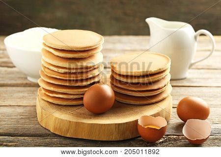 Tasty Pancakes With Eggs On Grey Wooden Table