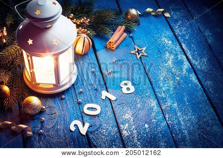 Burning lantern and christmas decoration in the evening