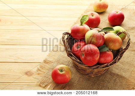 Ripe And Sweet Apples In Basket On Wooden Table