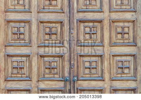 The old wooden door wide the squares