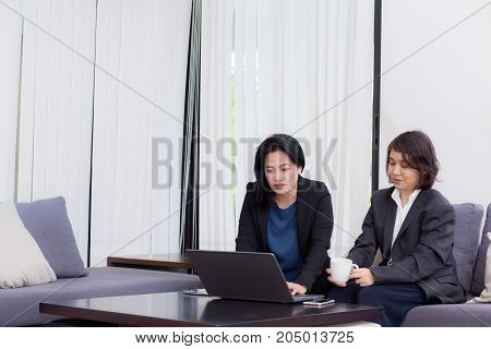 senior and junior businesswoman discuss something during their meeting.