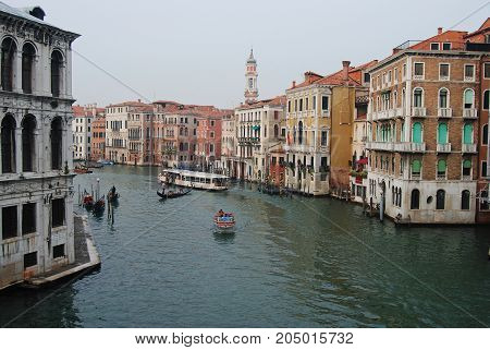 Venice, Italy - October 16, 2014. Grand Canal in Venice with historic buildings, boats and people.