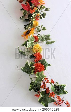 Artificial flowers and greenery on a white background.