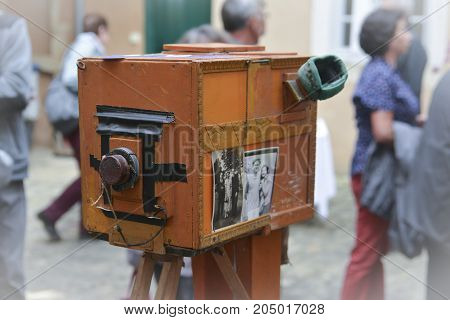 LE MANS FRANCE - OCTOBER 02 2016: Old big vintage camera of wood and metal close on the street of France