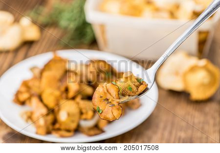 Fried Chanterelles On Wooden Background; Selective Focus