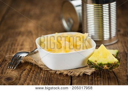 Portion Of Chopped Pineapple (preserved) On Wooden Background, Selective Focus