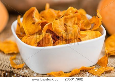 Sweet Potato Chips On Wooden Background; Selective Focus