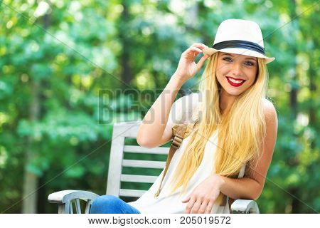Young woman sitting outside on a beautiful summer day