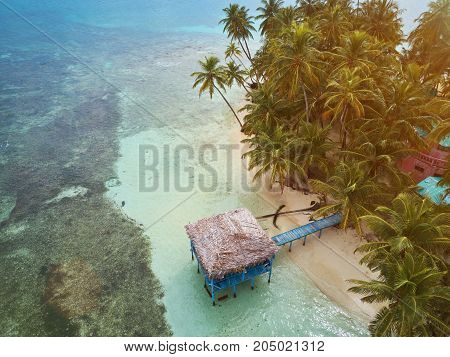 Bungalow on caribbean island aerial drone view