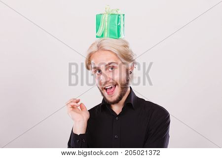 Man With Green Gift Box On His Head