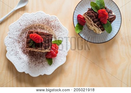 Strawberry tiramisu with mascarpone wood background top view