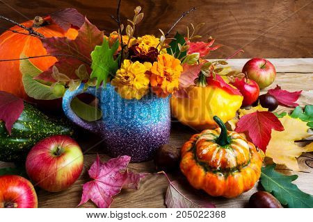 Rustic Fall  Table Centerpiece With Pumpkins And Leaves, Close Up
